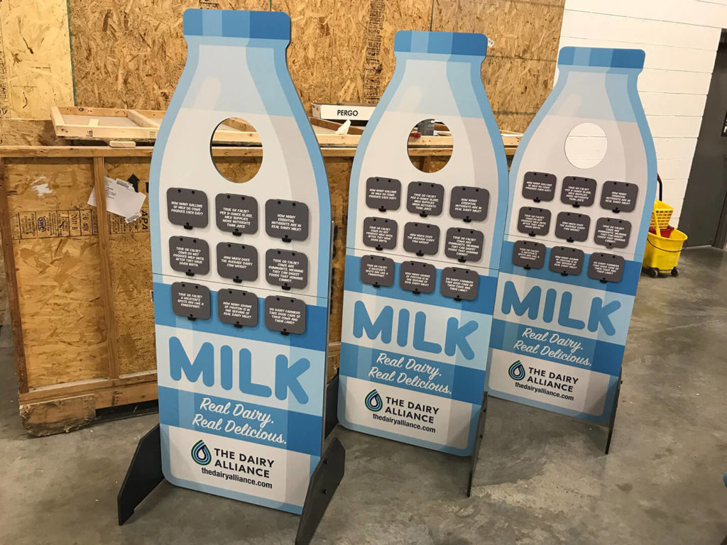 Three standup milk bottle displays, used for teaching about dairy products