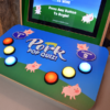 Closeup of the buttons and graphics on the pork trivia game
