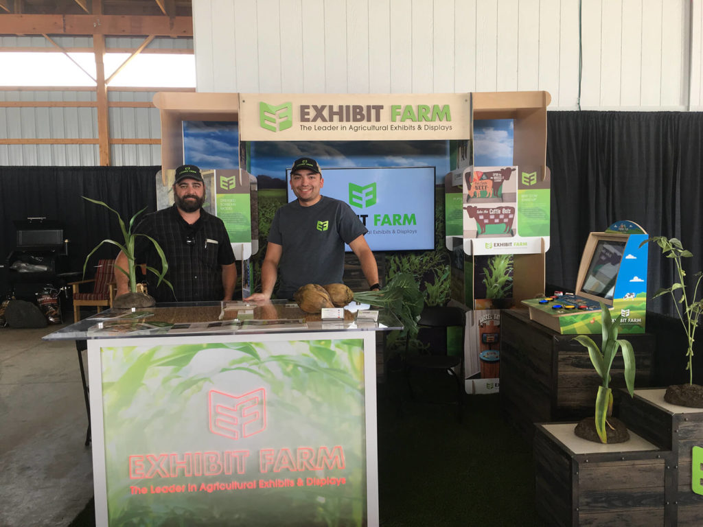The Exhibit Farm booth, showing many of our signature products, at the 2019 AgroExpo in St Johns Michigan