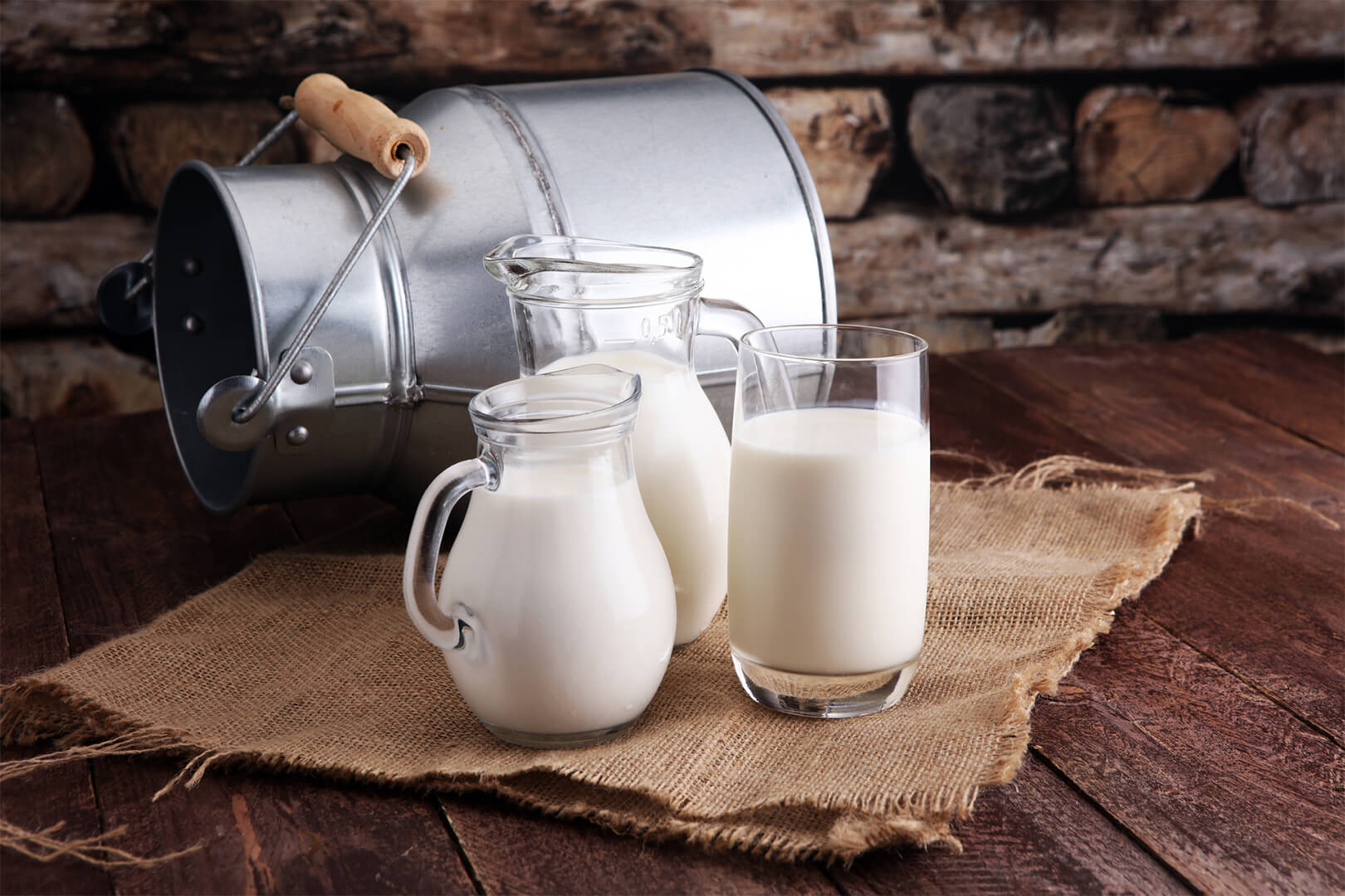Can of milk and three glasses of milk; used for article on raw vs pasteurized milk