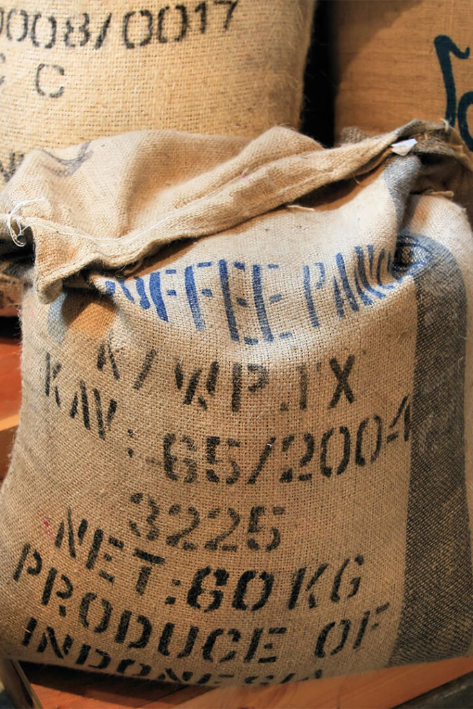 Closed burlap bag of coffee; used in article about coffee certifying labels