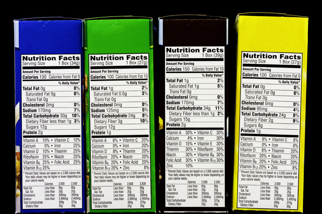 Nutrition panels on four cereal boxes; used in an article about fortified foods