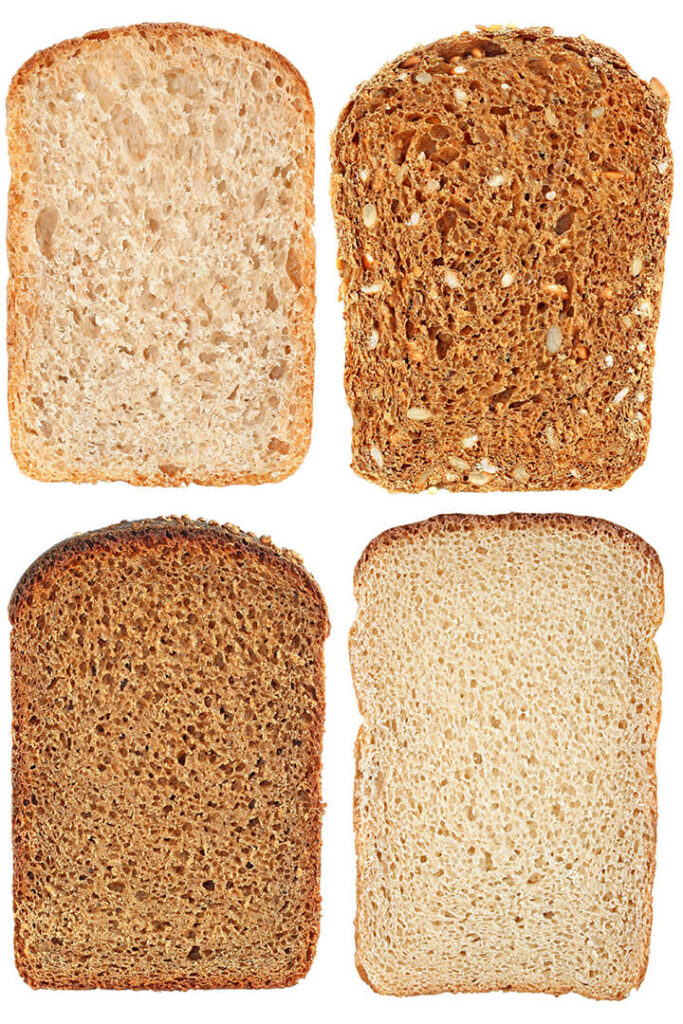 Slices of four different kinds of sandwich bread