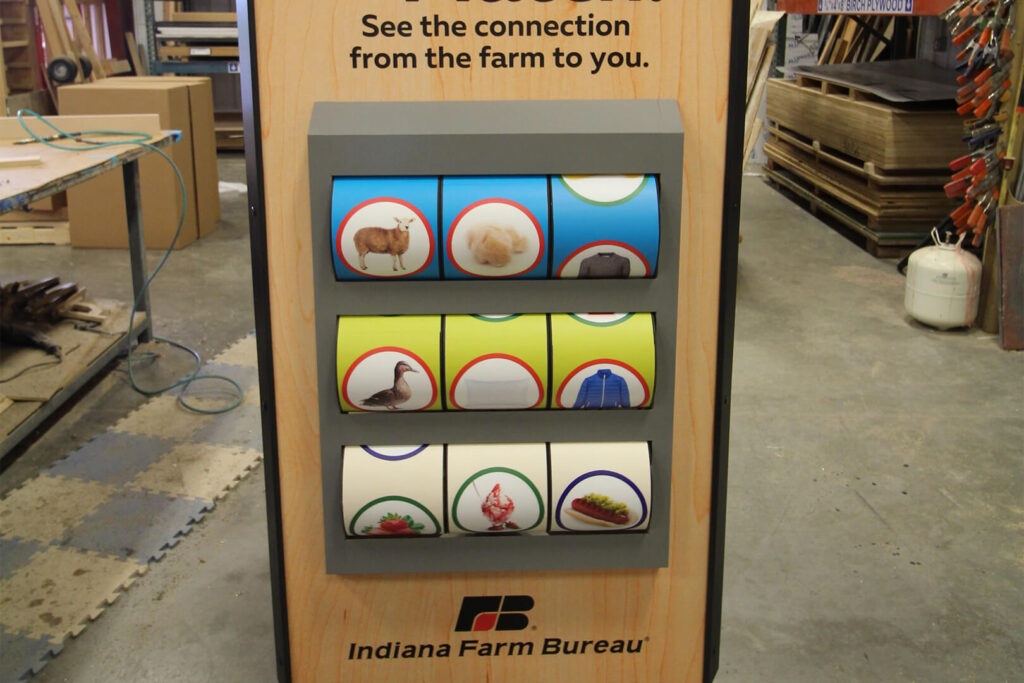 Closeup of Exhibit Farm's Make the Match display, designed to show the connections from farm to store