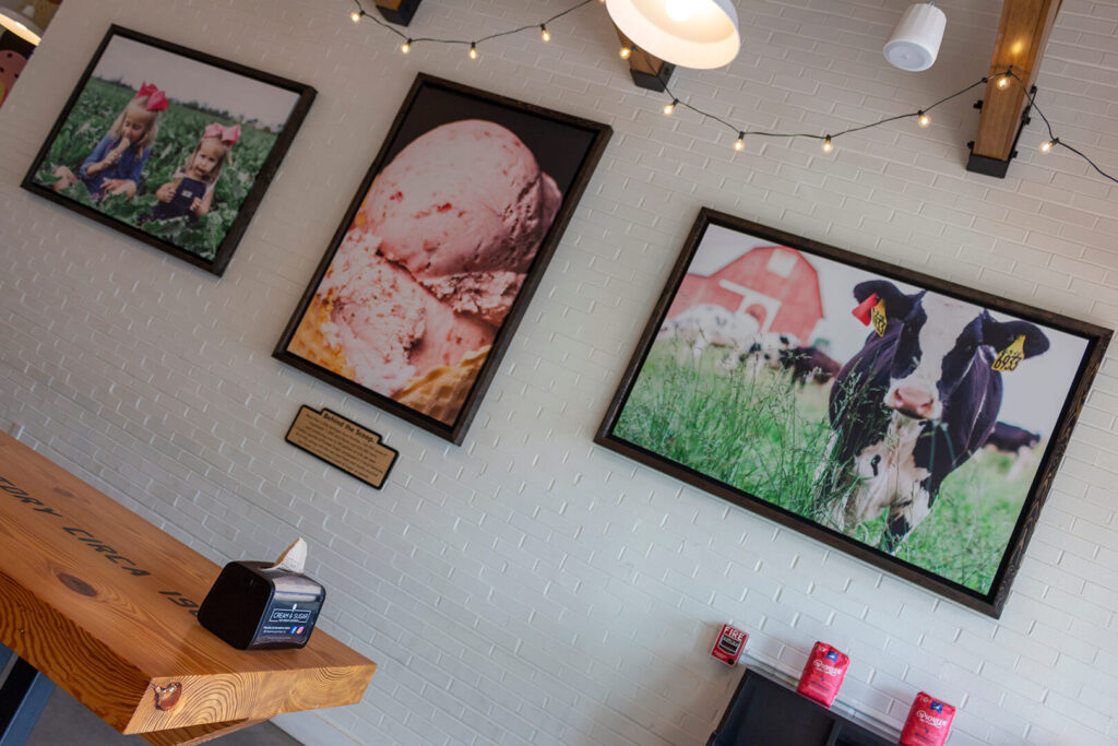 Three prints in an ice cream shop, representing partnerships with two ag groups
