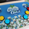 Closeup of buttons and graphics on cotton trivia game