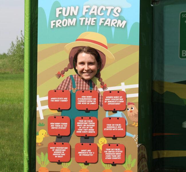 A girl smiling through the girl farmer photo op