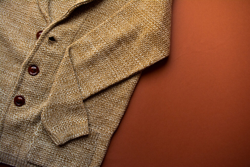 Tan wool sweater against a chestnut background
