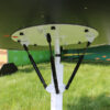 The underside of the tilt table game, showing the gas shocks that let it rotate