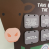 Closeup of the cow graphics and two rows of flip-up fact panels