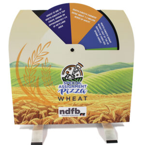 Tabletop display of a wheel with facts about wheat