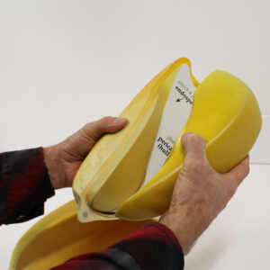 Person assembling the pull-apart corn kernel model
