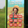 Girl smiling through the face slot on the girl farmer photo op